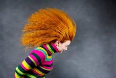 女孩头发的行动红色 库存图片