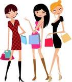 女孩购物的三 免版税库存照片