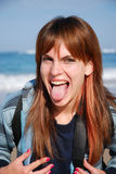 女孩贯穿的舌头 免版税库存图片