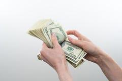 女孩说10000美元手中 免版税库存照片