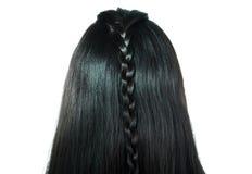 女孩黑色发光的被打褶的头发背面图  免版税图库摄影