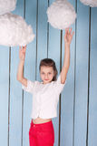 女孩画象在白色云彩下的 库存图片
