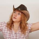 女孩画象有帽子的在头 免版税图库摄影