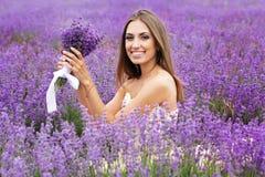 女孩画象有时尚构成的在淡紫色 免版税图库摄影