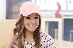 女孩画象棒球帽的 图库摄影
