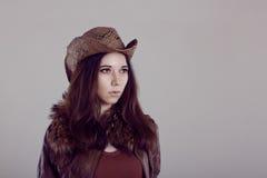 女孩画象牛仔草帽的 库存照片