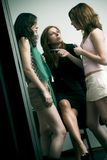 女孩说闲话的三 免版税库存图片