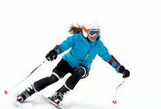 女孩滑雪。 库存照片