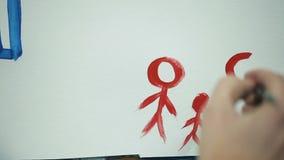 女孩` s手在纸的图画家庭