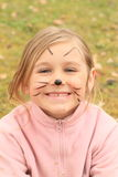 女孩drawen作为猫 免版税库存图片