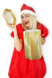 女孩klaus ・圣诞老人 免版税库存照片