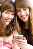 女孩MP3播放器 免版税库存照片