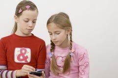 女孩palmtop 免版税库存图片