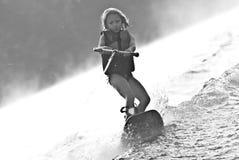 女孩wakeboard年轻人 免版税库存照片