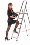 女实业家上升的梯子 免版税库存图片