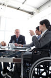 女实业家会议轮椅 免版税库存图片
