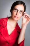 女实业家佩带的玻璃 免版税图库摄影
