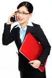 女实业家告诉与某人由移动pho 免版税库存图片