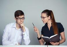 女实业家和乏味干事 免版税库存照片