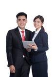女实业家和商人使用片剂个人计算机在白色背景 免版税库存照片