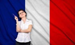 女实业家和法国旗子 免版税库存照片