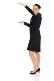 女实业家在手上的拿着拷贝空间 免版税图库摄影
