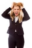 女实业家拉扯她的头发和尖叫在失望 库存照片