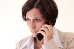 女实业家方便不快乐的白色 免版税库存图片
