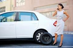 女实业家泄了气的轮胎 库存图片