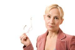 女实业家玻璃递粉红色 库存图片