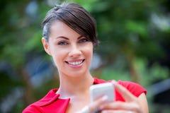女实业家画象有手机的 免版税图库摄影
