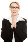 女实业家祈祷的诉讼 库存图片