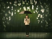 女实业家站立与伞的和3d数字下雨浓缩 免版税库存照片