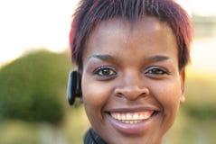 女实业家耳机 图库摄影