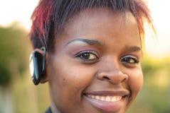 女实业家耳机 免版税图库摄影