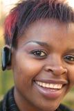 女实业家耳机 免版税库存图片