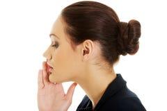 女实业家耳语对某人 库存照片