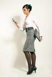 女实业家膝上型计算机电话 免版税库存照片