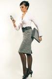 女实业家膝上型计算机电话 免版税库存图片