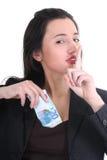 女实业家隐藏的货币 免版税库存图片