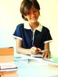 女小学生微笑 免版税库存照片