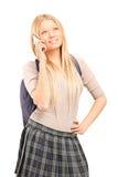 女小学生谈话在手机 免版税库存图片