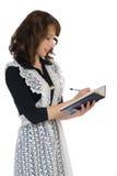 女小学生采取笔记 免版税库存图片