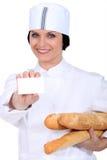 女店员在面包店商店 库存图片
