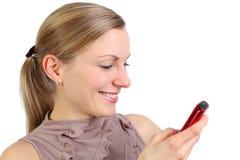 女性传讯年轻人 免版税库存照片