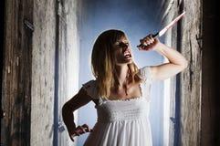 女性危险吸血鬼 库存照片