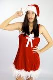 女性圣诞老人有圣诞节的一个想法 库存图片