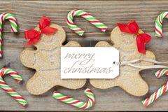 女性姜饼糖果的图象与一个圣诞快乐标记的 免版税图库摄影