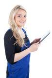 女性工匠/女工匠有数字式片剂的 免版税库存图片