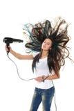 女性干燥她的头发以更加头发干燥 库存照片